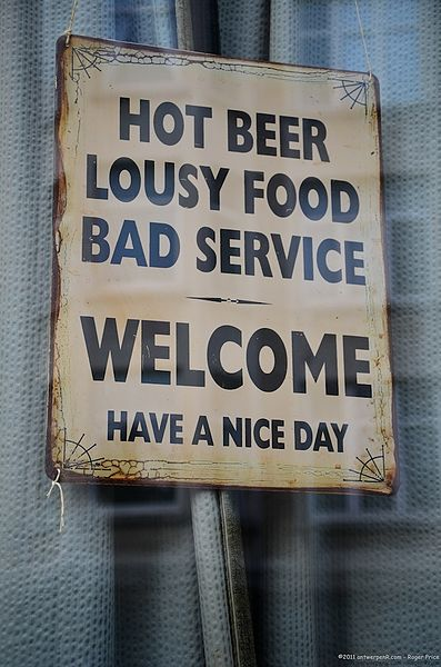397px-Hot_beer,_lousy_food,_bad_service_-_Welcome,_have_a_nice_day_sign_in_Antwerp,_Belgium